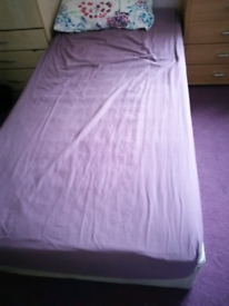 2 single beds and mattresses