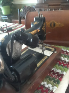 Vintage 1910 sewing machine with coffin case