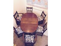 Ercol double winged dining table and 6 chairs