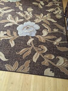 Floral brown area rugs large and small.$180 obo