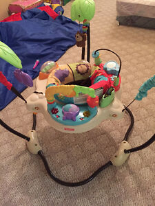 Excellent condition Exersaucer - lights up and plays music