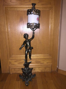 AN    ANTIQUE CHERUB LAMP FOR SALE