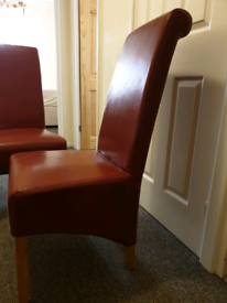 2 modern red leather chairs