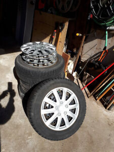 Snow Tires on Rims with Hubcaps