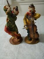 two clowns who play musical instruments
