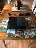 Xbox one with kinect (not pictured) 8 games 2 controllers