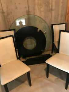 Glass top round table and four chairs