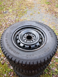 215 70 R15 studded tires on rims