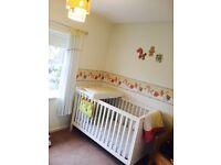 Full nursery interior and cot bed