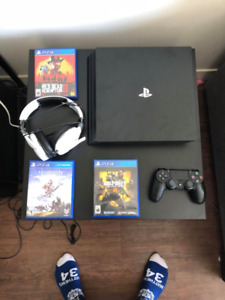 PS4 PRO 1TB w/RED DEAD 2,BLACK OPS 4 & MORE