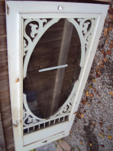 Victorian Wooden storm/screen door. 34 x 78 1/4 inches