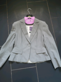 Brand new with tags. Grey 3 piece suit. By George.