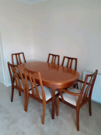 Extending table 4 high back chairs plus 2 matching carvers