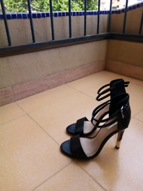New, never worn, size 5 ladies black high heeled shoes
