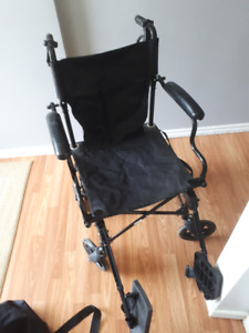 Fold up wheelchair with carrying case $100