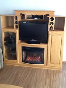 Custom designed oak entertainment center with fireplace