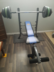 Approx 200 pounds of weights, bench, bars and dumbell