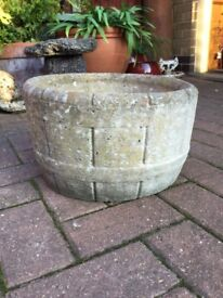 Pair of solid stone weathered garden planters or pots