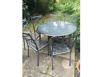 Very attractive grey metal garden table with 6 chairs