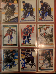Assorted autographed hockey and baseball cards