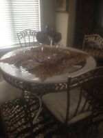 Ashley furniture table and four chairs with cast iron shelf