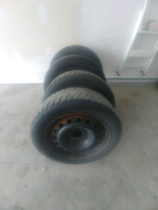 Tires 205/55R16 4 Winter Rims 3 Studded Tires