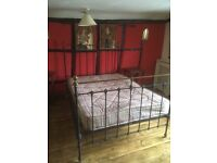 Antique wrought iron and brass bed