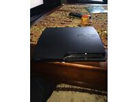 PlayStation 3 500GB Slim& 2 dual shock PS3 controllers