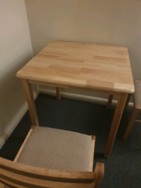 Dining table with 2 padded chairs