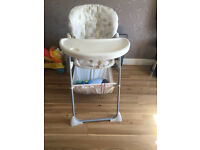 High chair with storage basket