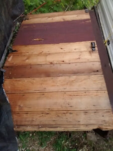 wooden garage doors and rolling track