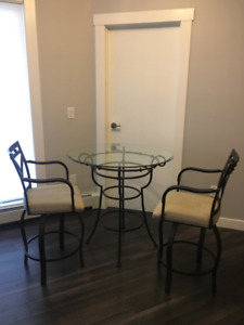 Small Glass Kitchen Table and Set of Swivel Chairs for $50