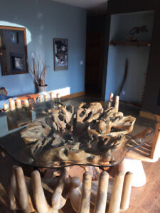 Glass root tree table and carved hand chairs