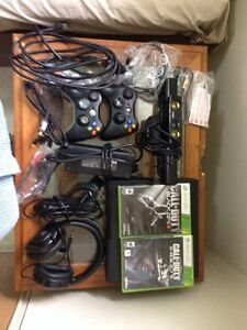 Xbox 360 e with accessories and games