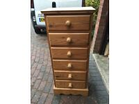 A SOLID BARE PINE TALL CHEST OF 6 DRAWERS