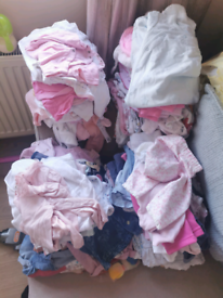 Large bundle of 6 to 9 month baby girls clothes.
