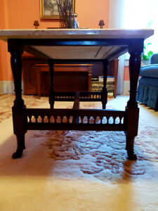 Antique marble slab coffee table on detailed wooden base.