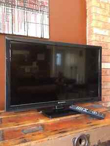 """27"""" flat screen TV with built in DVD player"""