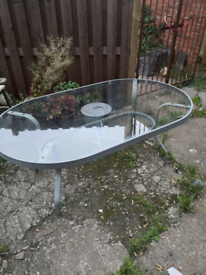 Large glass and metal garden table