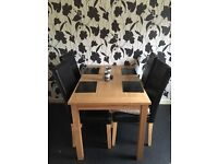 Dining Room Table and 4 Leatherette Chairs