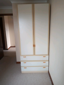 Wardrobe shelved with three drawers