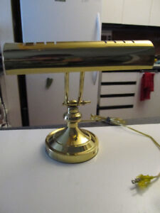 Brass piano lamp.