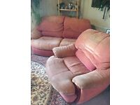 TWO PIECE RUST COLOURED SUITE TWO SEATER SOFA AND SINGLE CHAIR