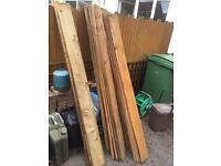 Featheredge fence boards and concrete gravel boards.