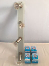 A quality glass spotlight bar,LED daylight bulbs with adjustable heads,costs £115,bargain £45