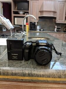 Panasonic Lumix FZ200 with strap, battery, and charger