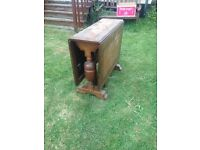 Possibly 1920's 1930's drop leaf folding table