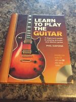Learn how to play guitar book with CD