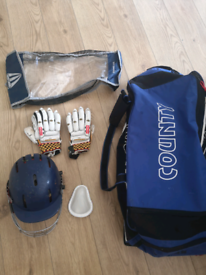 Cricket helmet and gloves and bag