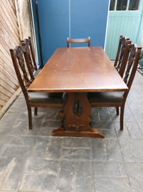 Dark wood dining table, 4 chairs, 2 carver chairs